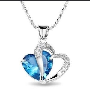 Jewelry - Blue heart shaped crystal gemstone on silver chain